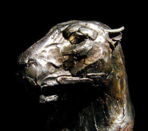 Leopard head sculpture by Dylan Lewis